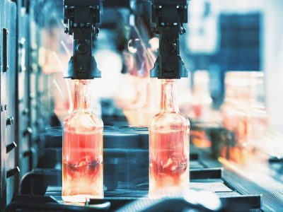 Hot glass bottles on the factory conveyor
